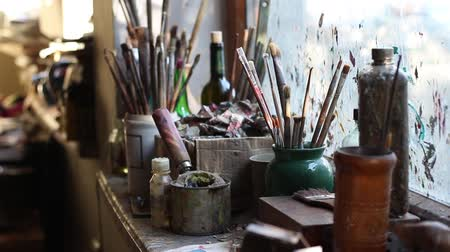 galeria : Art concept. The tools of an artist. Old brushes, Oil paints, Painting Solvents and Varnishes