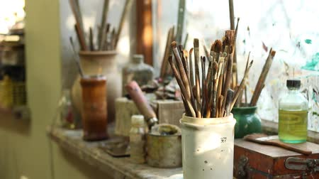 pitcher : Art concept. The tools of an artist. Old brushes, Oil paints, Painting Solvents and Varnishes