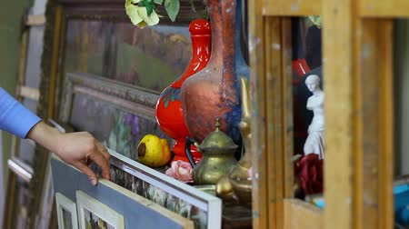 collectable : Shopping in antique shop. Person Looking At Old Antiques In Antique Shop. Painting
