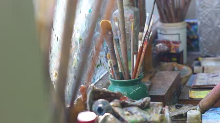 pitcher : Paint Brushes On The Windowsill. Old paintbrushes in a creative workshop. Artist Equipment
