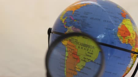 maquette : States In South America - Political Globe Through A Magnifying Glass. Earth with Political Maps with Blue Oceans for Educational Geography. Argentina, Bolivia, Brazil, Chile, Colombia, Ecuador, Paraguay, Peru, Uruguay, Venezuela Stock Footage