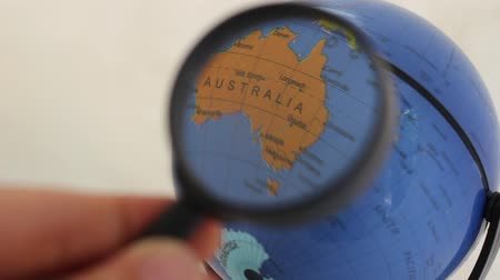 tasmania : Commonwealth Of Australia - World Globe Element Through A Magnifying Glass