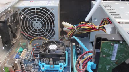 база : Computer Technician Blows Canned Air Into Cpu