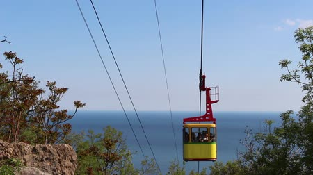 chairlift : Aerial lift going over sea Stock Footage