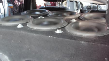 мегафон : Sub woofers close up. Bass SOUND WAVES. Loudest Sound System. Subwoofers are installed in the trunk or back seat space
