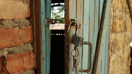 hayloft : Old Wooden Door & Open Padlock