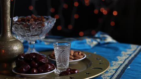 iftar : Fasting in the Holy Muslim month of Ramadan. The daily fast during Ramadan begins immediately after the pre-dawn meal of Suhur and remains during the daylight hours, ending with sunset with the even Stock Footage