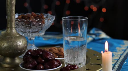 iftar : The pre-dawn meal of Suhur. Water and dates. Fasting in the Holy Muslim month of Ramadan