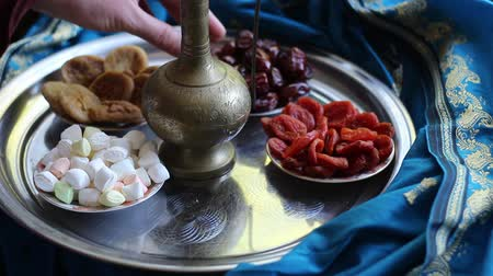 iftar : Muslim family. Iftar break fast spreads of water, dates, dried apricots. Traditional Dishes to Serve During Ramadan