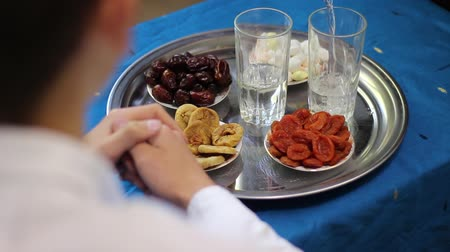 incir : People who keep roza. Iftar break fast spread consists of water, dates, dried apricots and figs. Ramadan is the holiest month of the year for Muslims