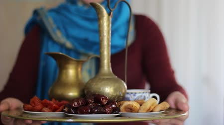 iftar : Eid Mubarak. A conceptual set of objects for Ramadan. Muslim woman wearing hijab
