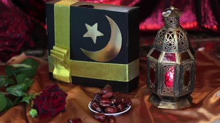 fete : Muslim gift and arabian lantern. Religious Holidays. Islamic holidays concept. Lights decoration in the background Stock Footage