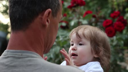 caring : little girl kissing father. Happy father with daughter in the garden