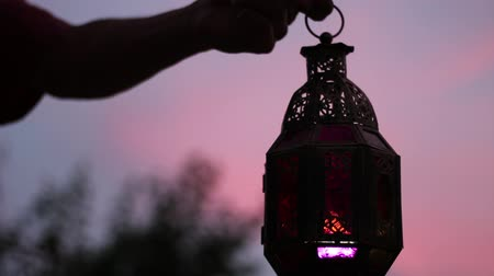iftar : Dawn of the Holy month of Ramadan. Muslim fast every day from dawn to sunset. Silhouette. Man holding a lantern Stock Footage