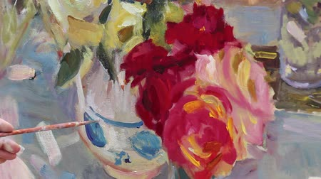 pitcher : Close up of mans hand painting still life picture on canvas in art studio. Etude with oil paints