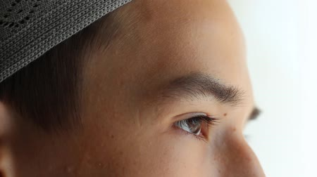 modlitba : Portrait close up. Religious Education. The young man in the mosque