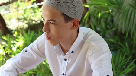 mianmar : Portrait of a Muslim young man with a traditional Islamic kufi hat
