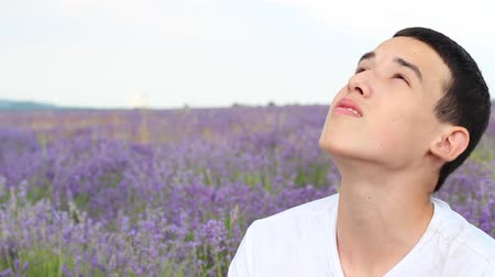 wistful : Boy Looking Up Sky Hope, Saying Prayer. Portrait Of Lonely Depressed Teen Alone In A Lavender Field Stock Footage