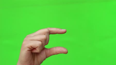 индекс : Hand Showing A Small Size Sign. Hand Gesture. Isolated. Green Screen Chromakey