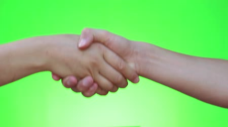 nonverbal : Handshake, shaking hands, handshaking. Two handed gesture. Chromakey. Green Screen. Isolated