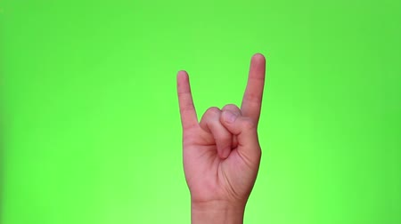 pinky : Sign of the horns. A rock on hand gesture. Heavy Metal. Chromakey. Green Screen. Isolated