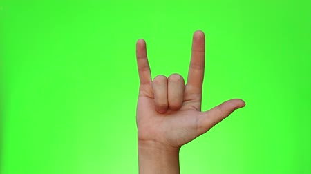 mainstream : ILY sign. I love you. Single handed gesture. Chromakey. Green Screen. Isolated