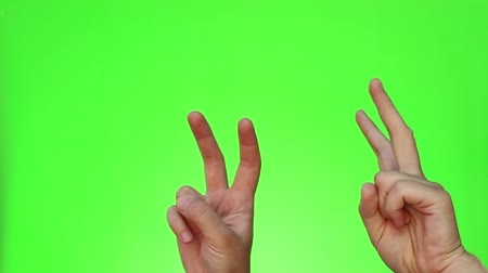 cytat : Air quotes. Finger quotes. Virtual quotation. Formed in the air with ones fingers when speaking. Chromakey. Green Screen. Isolated