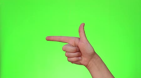 nonverbal : The finger gun sign. Single handed gesture. Chromakey. Green Screen. Isolated