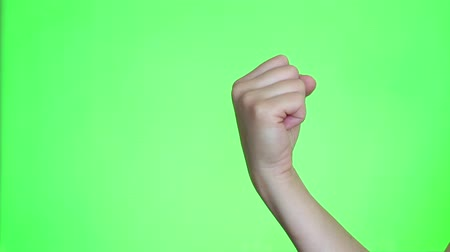 attainment : Fist pump. Attainment of a goal. Fist close-up. Chroma key background. Green Screen. Isolated
