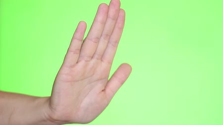 proibir : Man showing stop gesture. Hand close-up. Chroma key background. Green Screen. Isolated