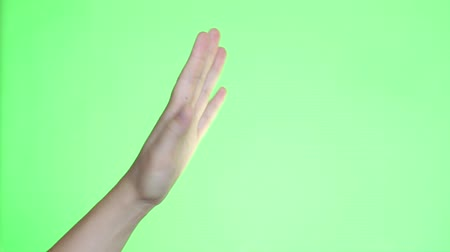 konferans : A man raising a hand and a finger to a question. Hand close-up. Chroma key background. Green Screen. Isolated Stok Video