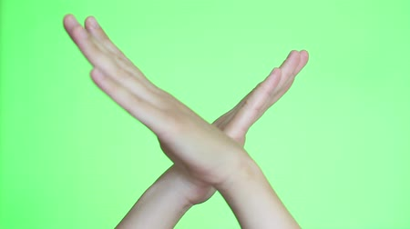 Çapraz kollar : A man crossed his arms showing stop closeup. Chroma key background. Green Screen. Isolated Stok Video