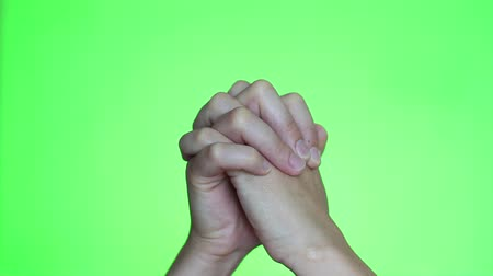 repentance : Hands praying. Chroma key background. Green Screen. Isolated