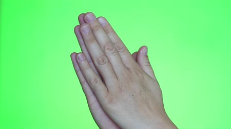 repentance : Female hands praying closeup. Chroma key background. Green Screen. Isolated Stock Footage