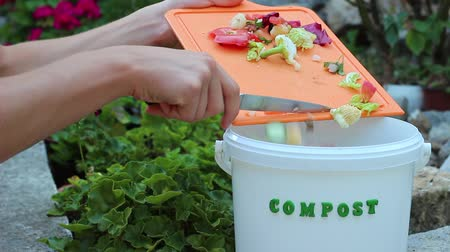 humanóide : Organic waste for fruits and vegetables. Household garbage, recycling and composting. Environment concept Stock Footage