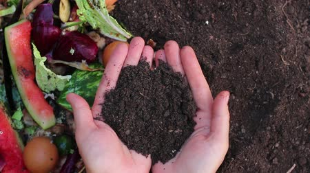leftover : Recycles Kitchen and Yard Waste. Soil in the hands of the gardener. Optimal Compost Ingredients To Create Rich Black Soil