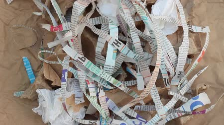 leftover : Shredded Paper for Compost or Mulch in Garden. Newspaper, cardboard, egg cartons Stock Footage