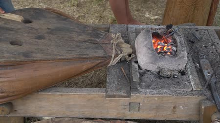 ar : Medieval Forge. Blacksmithing. Blacksmith Working a Medieval Forge