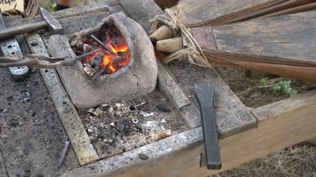 smolder : Medieval Forge. Blacksmithing. Blacksmith Working a Medieval Forge