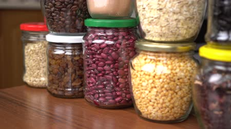 Shop in Bulk. Glass Cereal Jars. Food storage in pantry. Zero Waste Shopping Stock Footage