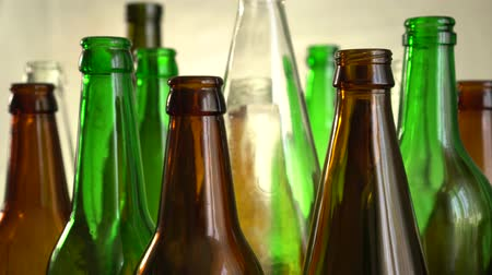 Empty used bottles and jars. Household waste. Glass products can be easily recycled and repurposed Stock Footage