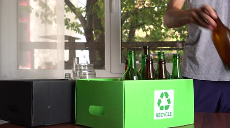 Recycling box for glass. Empty used bottles and jars recycle. Household waste separation