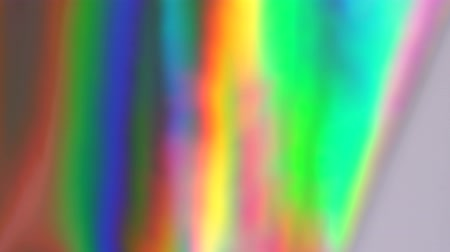 Holographic foil background. Rainbow gradient. Dynamic motion Стоковые видеозаписи