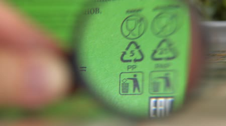 id : Plastic recycle. Resin identification codes (RIC) on food packaging. Polypropylene and paperboard. Waste disposal, recycling, reduction Stock Footage