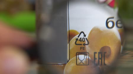 Metal Recycling Symbol on food container. A tin can, tin, steel can, steel packaging. Waste disposal