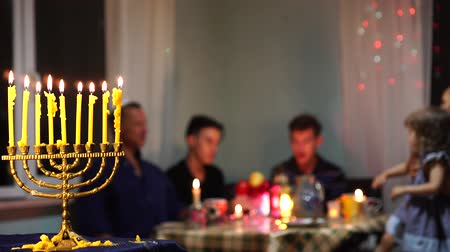 ziyafet : Happy Jewish Family Celebrates Hanukkah. Festival of Lights. Israel people. The hanukkah menorah Stok Video