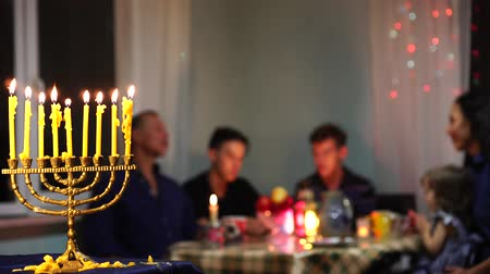 Happy Jewish Family Celebrates Hanukkah. Festival of Lights. Israel people. The hanukkah menorah Стоковые видеозаписи