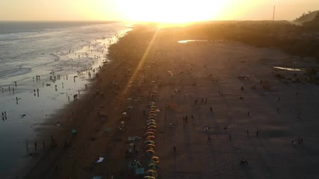 lő : Aerial footage of Parangtritis beach  during sunset. Parangtritis beach, a popular tourist beach  on the southern coast of Java in the Bantul Regency within the province of the Yogyakarta Special Region, Indonesia.