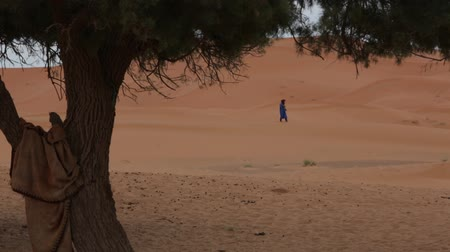 relics : The Waiting Man in the Desert. Moroccan desert. Moroccan man. The waiting man in the desert.