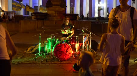 resourceful : Odessa, Ukraine - June 26, 2016: Young man on the street playing the drums. Evening time. Video was obtained in a public place in the open event with a free input.